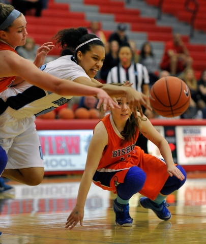 Centennial's Jayden Eggleston, center, reaches out for the ball against Bishop Gorman's Megan Jacobs, left, and Madison Ulrey during the Sunset Region girls basketball championship game at Arbor V ...