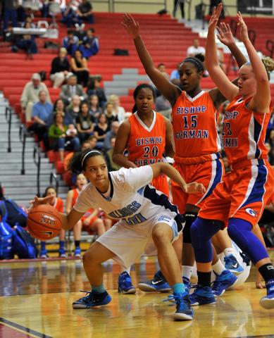 Centennial's Jayden Eggleston, left, dribbles the ball against Bishop Gorman's Samantha Coleman (20), Madison Washington (15) and Megan Jacobs (23) during the Sunset Region girls basketball champi ...