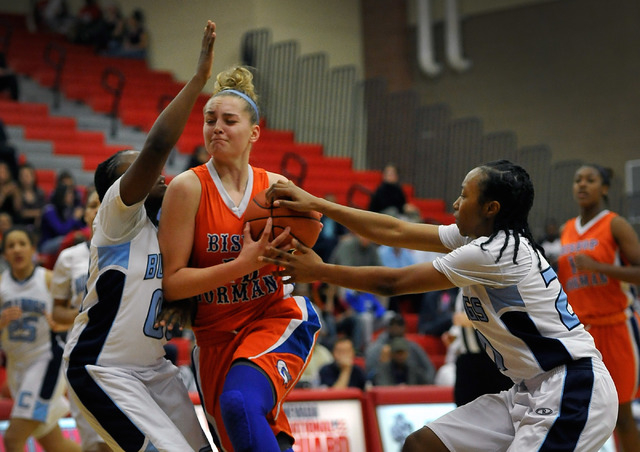 Bishop Gorman's Megan Jacobs, center, is double teamed by Centennial's Tanjanae Wells, left, and Justice Ethridge during the Sunset Region girls basketball championship game at Arbor View High Sch ...