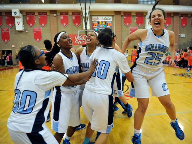 Centennial team members celebrate including Karina Brandon (25) after the Bulldogs defeated Bishop Gorman at the Sunset Region girls basketball championship game at Arbor View High School in Las V ...