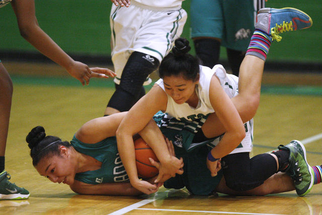 Rancho guard Tatianna Lee and Green Valley guard Gracelle Garcia fight for a loose ball during their game Tuesday, Feb. 3, 2015 at Green Valley. Green Valley won 44-38.  (Sam Morris/Las Vegas Revi ...