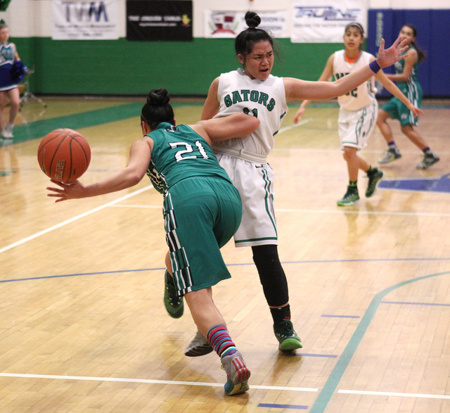 Green Valley guard Gracelle Garcia is shoved by Rancho guard Tatianna Lee during their game Tuesday, Feb. 3, 2015 at Green Valley. Green Valley won 44-38.  (Sam Morris/Las Vegas Review-Journal)