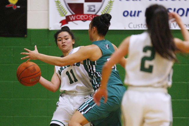 Green Valley guard Gracelle Garcia passes around Rancho guard Tatianna Lee during their game Tuesday, Feb. 3, 2015 at Green Valley. Green Valley won 44-38.  (Sam Morris/Las Vegas Review-Journal)