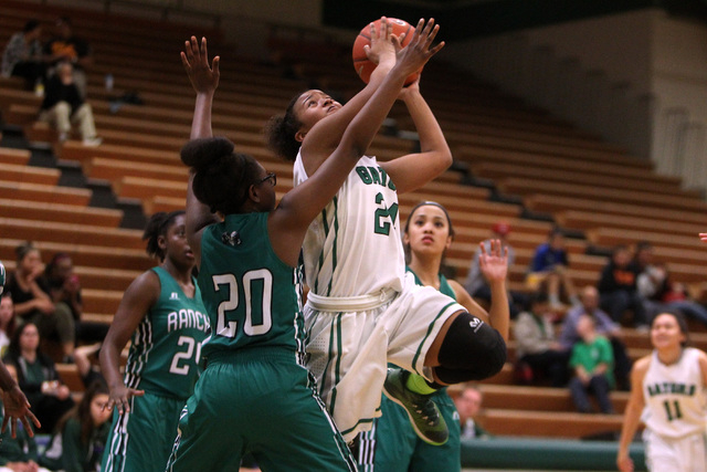 Green Valley's Yamilei Rodriguez is defended by Rancho guard Ashlynn McCall during their game Tuesday, Feb. 3, 2015 at Green Valley. Green Valley won 44-38.  (Sam Morris/Las Vegas Review-Journal)