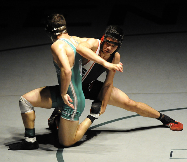 Alii Stewart of Las Vegas High School, left, tries to take down Jiar Meagher of Green Valley during the 160 pound final of Sunrise Region Wrestling tournament at Green Valley High School in Hender ...