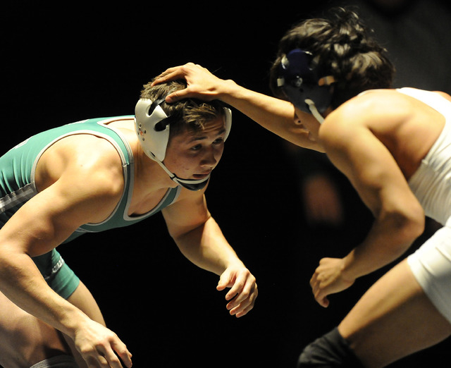 Sean Cannon of Green Valley, left, wrestles Michael Martinez of Liberty during the 132 pound final of Sunrise Region Wrestling tournament at Green Valley High School in Henderson, Saturday, Feb. 0 ...