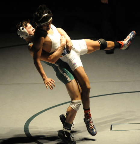 Sean Cannon of Green Valley, slams Michael Martinez of Liberty, to the mat during the 132 pound final of Sunrise Region Wrestling tournament at Green Valley High School in Henderson, Saturday, Feb ...