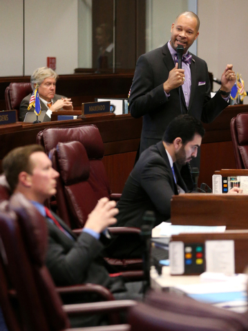 Nevada Senate Minority Leader Aaron Ford, D-Las Vegas, speaks on the Senate floor against a bill that will exempt school and university construction projects from prevailing wage laws, at the Legi ...