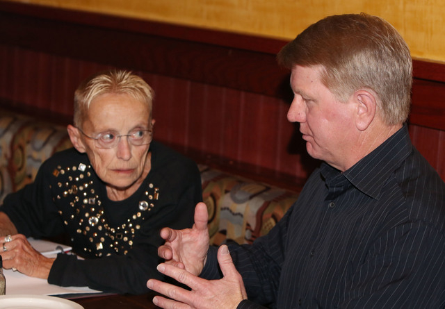 Jim Marchant, right, talks to AJ Maimbourg, recall organizer, on Thursday, Feb. 19, 2015. Marchant hopes to run against Assemblyman John Hambrick, R-Las Vegas, in a potential recall election for t ...