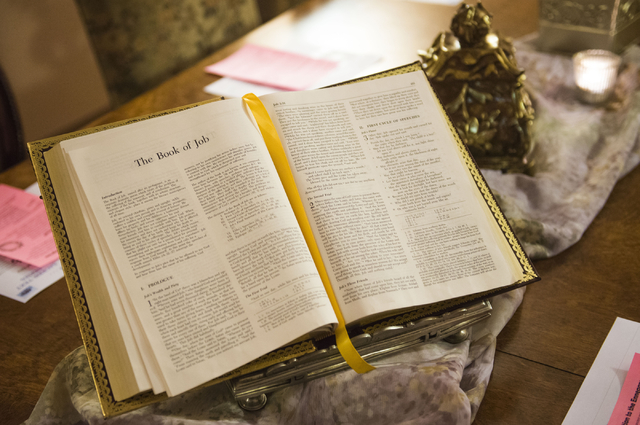 A Bible is open to the Book of Job at the Stillpoint Center for Spiritual Development in Las Vegas. Stillpoint offers a gathering place for individuals who want to work on spiritual development th ...