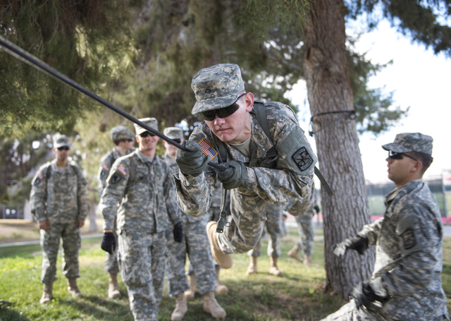 ROTC cadet Brett Willis, 19, conducts a commando crawl during a rope-bridge leadership drill at the UNLV practice football field on the UNLV campus in Las Vegas on Friday, Feb. 6, 2015. (Martin S. ...