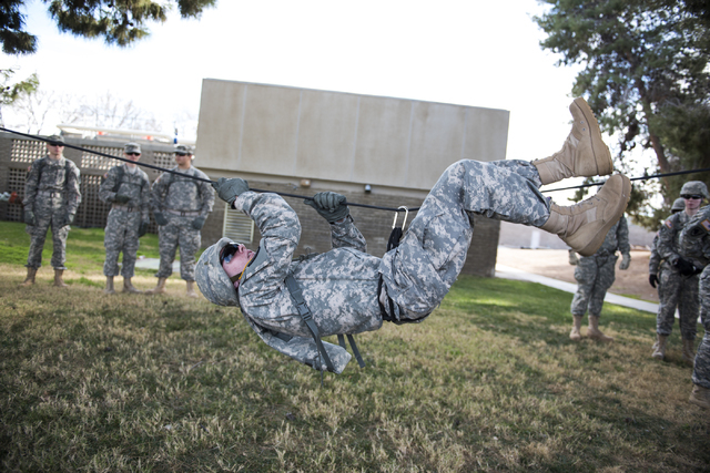 ROTC cadet Brett Willis, 19, conducts a monkey crawl during a rope-bridge leadership drill at the UNLV practice football field on the UNLV campus in Las Vegas on Friday, Feb. 6, 2015. (Martin S. F ...