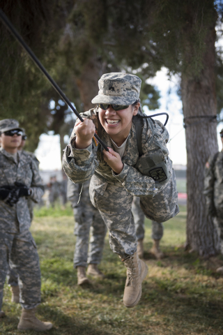 ROTC cadet Bridget Dorcey, 19, conducts a commando crawl during a rope-bridge leadership drill at the UNLV practice football field on the UNLV campus in Las Vegas on Friday, Feb. 6, 2015. (Martin  ...