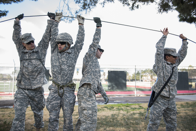 ROTC cadets assists with the tension of the line during a rope-bridge leadership drill at the UNLV practice football field on the UNLV campus in Las Vegas on Friday, Feb. 6, 2015. (Martin S. Fuent ...