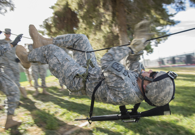 ROTC cadet James Querubin, 21, conducts a monkey crawl during a rope-bridge leadership drill at the UNLV practice football field on the UNLV campus in Las Vegas on Friday, Feb. 6, 2015. (Martin S. ...