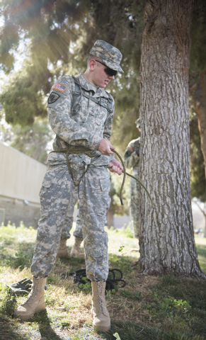 ROTC cadet Brett Willis, 19, tightens his improvised climbing harness during a rope-bridge leadership drill at the UNLV practice football field on the UNLV campus in Las Vegas on Friday Feb. 6, 20 ...