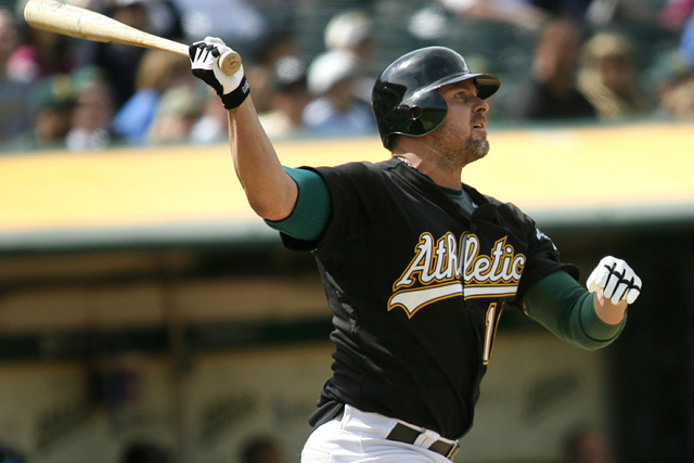 Oakland Athletics' Jason Giambi hits a two-run home run, his second of the game, in the ninth inning against the Toronto Blue Jays in an American League MLB baseball game in Oakland, California, M ...
