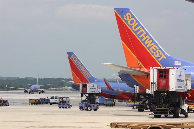 Southwest Airlines jets sit on the tarmac at a gate of Baltimore-Washington International Airport. (CNN)