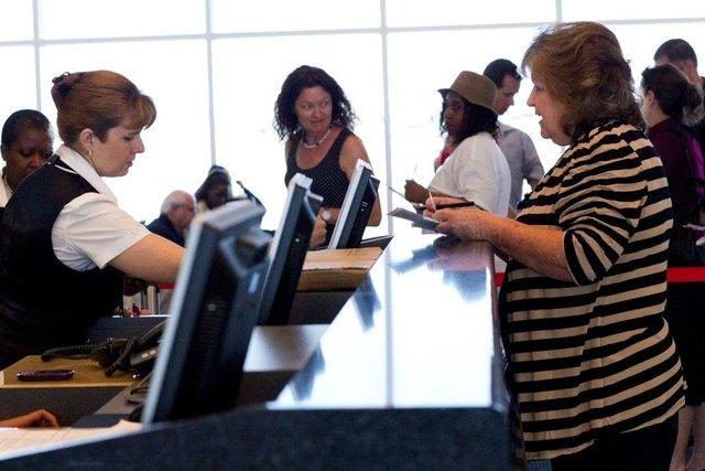 A passenger talks with an airline representative at the Hartsfield-Jackson Atlanta International Airport Maynard H. Jackson Jr. International Terminal. (CNN)