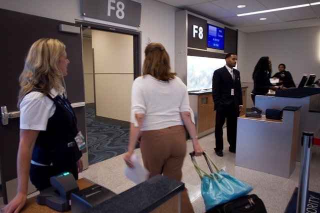 A passenger prepares to board a plane at gate F8 at the Hartsfield-Jackson Atlanta International Airport Maynard H. Jackson Jr. International Terminal. (CNN)