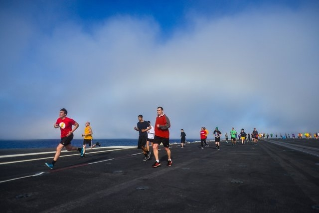 Navy photographer Ignacio Perez captured a shot of the USS John C. Stennis 1,100-foot-long warship as it was cruising in the Pacific Ocean steaming through a rainbow on Feb. 3, 2015. A 5K run was  ...