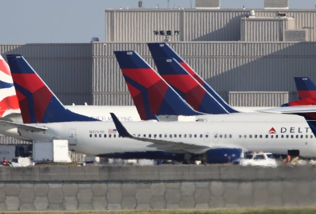 A Delta Airlines jet sits on the tarmac at the Atlanta Hartsfield-Jackson International Airport. (CNN)