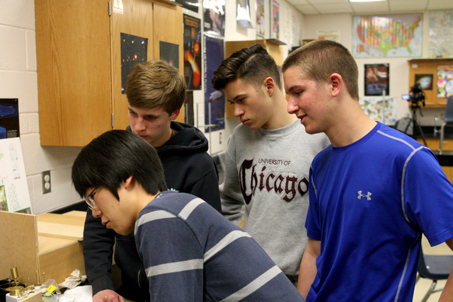 Jake Lee,left front, Corbin Smart, Alexander Gibson and Thomas Conibear from Green Valley High School demonstrate some of the inner workings of the safe they have designed for a safe-cracking comp ...