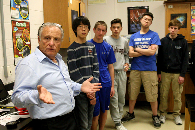Dr. Ariel Heimann, Director General of the Davidson Institute, talks with faculty and students, Jake Lee,left, Thomas Conibear, Alexander Gibson, David Li and Corbin Smart, at Green Valley High Sc ...