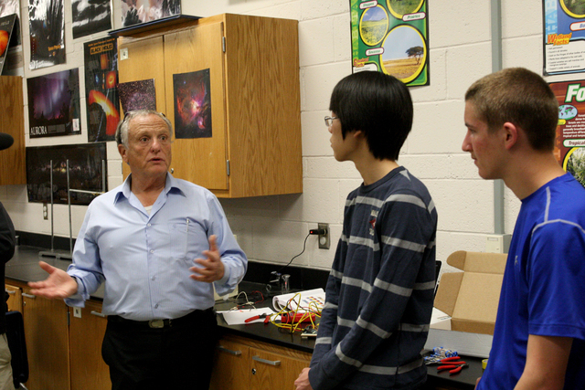 Dr. Ariel Heimann, Director General of the Davidson Institute, talks with Green Valley High School students, Jake Lee and Thomas Conibear who are with one of four Las Vegas teams entering a safe-c ...