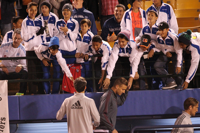 Fans cheer for Colorado's players before the start of their game against San Jose for a Major League Soccer game at Cashman Field in Las Vegas Sunday, Feb. 15, 2015. San Jose won 2-0. (Erik Verduz ...
