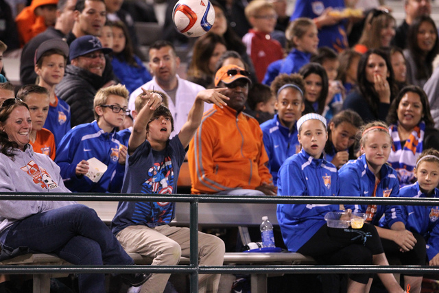 A fan throws a ball to the field during a Major League Soccer game between San Jose and Colorado at Cashman Field in Las Vegas Sunday, Feb. 15, 2015. San Jose won 2-0. (Erik Verduzco/Las Vegas Rev ...