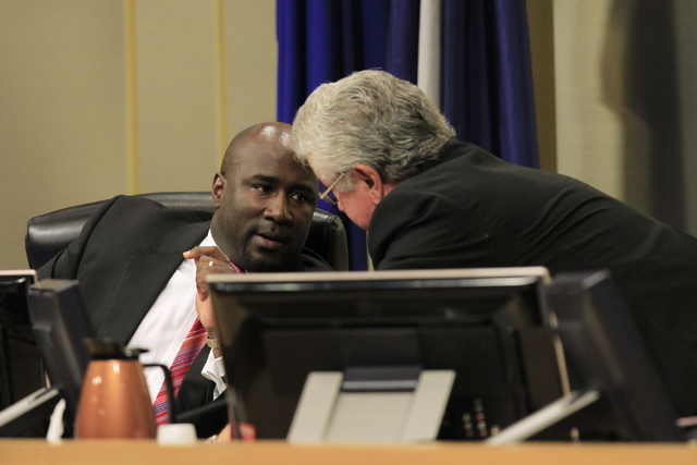 Councilmen Ricki Barlow, left, and Bob Coffin confer as a vote approaches on a proposed soccer stadium during a Las Vegas City Council meeting Wednesday, Oct. 1, 2014. (Sam Morris/Las Vegas Review ...