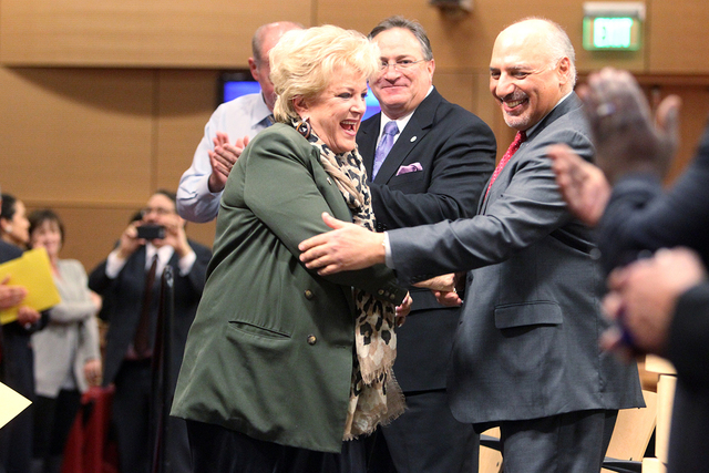 Las Vegas Mayor Carolyn Goodman, left, greets Mayor Pro Tem Stavros Anthony, right, and other members of the City Council before delivering her State of the City speech at City Hall Thursday, Jan. ...