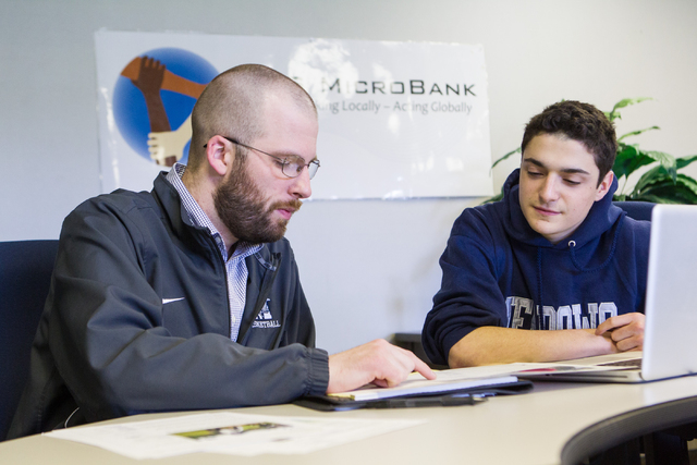 TMS Microbank faculty advisor Adam Betzelberger, left, analyzes possible investments with sophomore Michael Blau, who will be the group's president beginning in is junior year, at The Meadows Scho ...