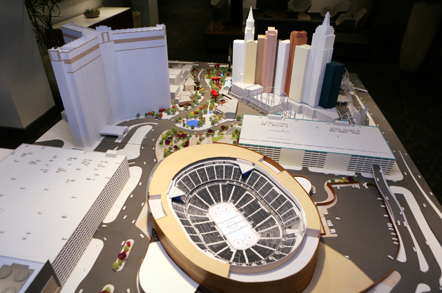 A model of the MGM-AEG arena depicting the arena that is currently under construction behind New York- New York hotel-casino is shown at the MGM Resorts International-AEG arena sales center Wednes ...