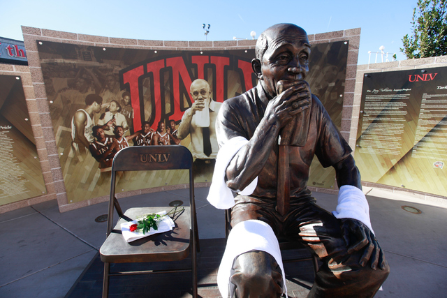The statue of former UNLV coach Jerry Tarkanian is draped with towels and a rose is left outside of the Thomas & Mack Center in Las Vegas on Wednesday, Feb. 11, 2015. Tarkanian died Wednesday. He  ...