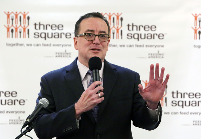 Brian Burton, president and CEO of Three Squares Food Bank, gestures as he announces a new contribution on Friday, Feb. 20, 2015, to Three Square Food Bank with the Ralph and Betty Engelstad Famil ...