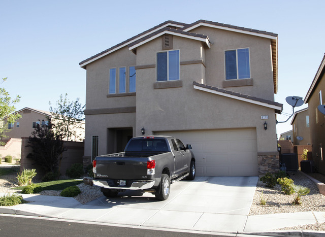 The home at 9218 Wittig Ave. in northwest Las Vegas was the scene of a shooting early Thursday, June 5, 2014. A man who believed his home was being burglarized shot through a door, hitting a man i ...