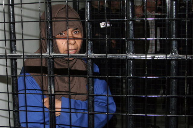 Iraqi Sajida al-Rishawi, 35, stands inside a military court at Juwaida prison in Amman in this April 24, 2006 file photo. Jordan has executed by hanging al-Rishawi, a jailed Iraqi woman militant w ...
