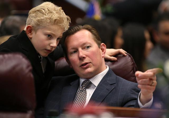Nevada Sen. Ben Kieckhefer, R-Reno, talks with his son Austin, 8, during opening day ceremonies at the Legislative Building in Carson City, Nev., on Monday, Feb. 2, 2015. (Cathleen Allison/Las Veg ...