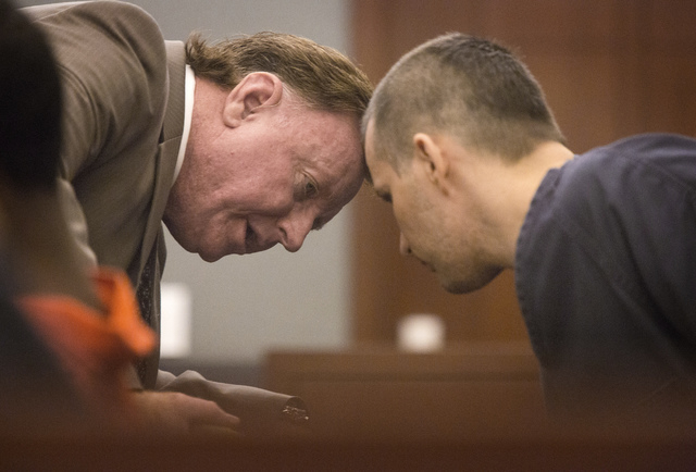 Gabriel Yates, right, confers with is attorney Robert Langford on Wednesday, Sept. 18, 2013 in Regional Justice Center. Yates and Anne Osburn  are charged in the murder and mutilating the body of  ...