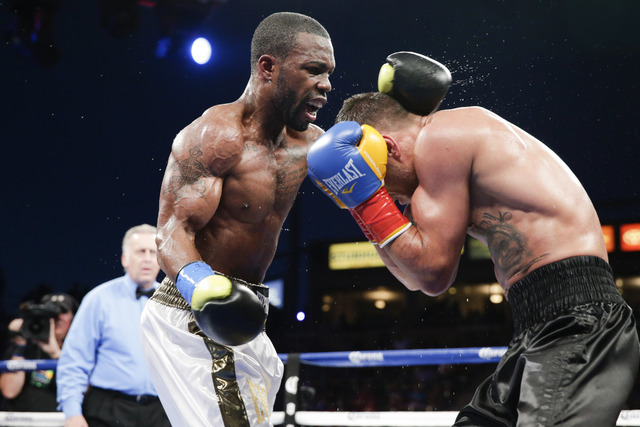 Featherweight Gary Russell Jr., left, mixes it up against Vasyl Lomachenko of Ukraine on June 21 at Carson, Calif. Lomachenko won the vacant World Boxing Organization belt by unanimous decision, h ...