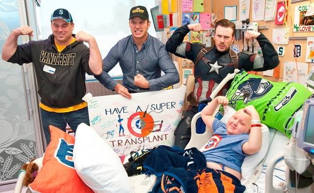 It was their second hospital visit as part of a Super Bowl bet that ended in a win for everyone. (Courtesy, Seattle Children's Hospital/Facebook)