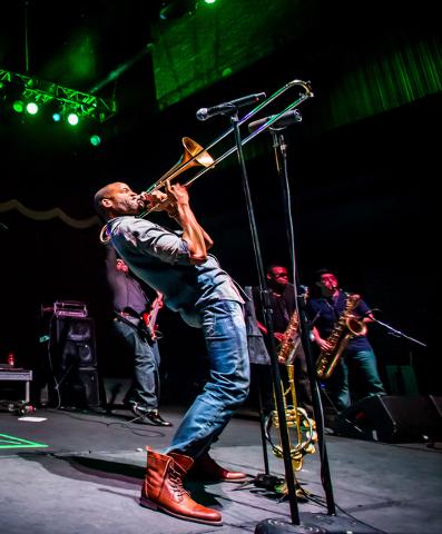 Trombone Shorty & Orleans Avenue performs at Brooklyn Bowl in Las Vegas, NV on December 30, 2014. (Courtesy, Erik Kabik/Retna Ltd.)