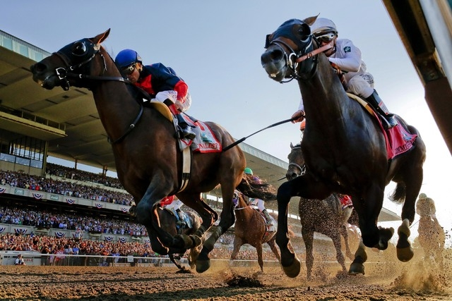 Tonalist, left, with Joel Rosario up edges out Commissioner with Javier Castellano up to win the 146th running of the Belmont Stakes horse race, Saturday, June 7, 2014, in Elmont, N.Y. (AP Photo/M ...