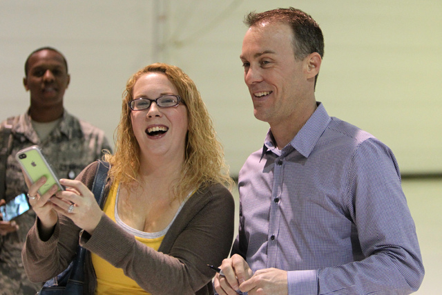 Jessica Miller, left, recreation aide at Nellis Air Force Base, smiles as she takes a photo with NASCAR driver Kevin Harvick during an appearance at Nellis Air Force Base in Las Vegas Tuesday, Dec ...