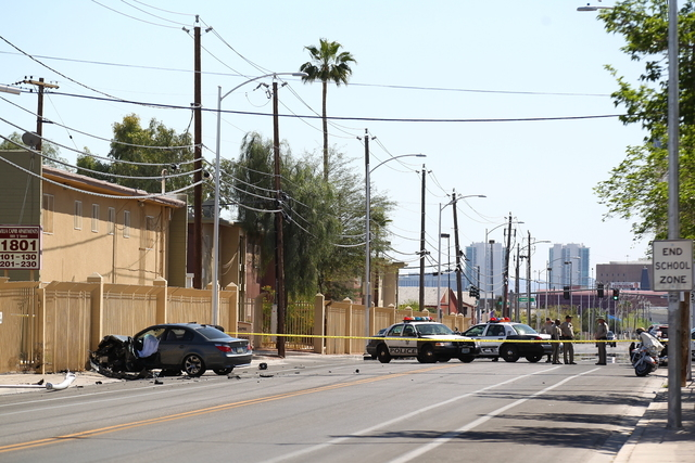 The driver of a vehicle that crashed into a light pole died Tuesday afternoon, according to Las Vegas police, and a central valley intersection is shut down while officers investigate. (Chase Stev ...