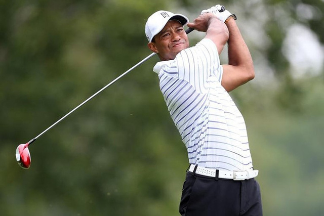Aug 8, 2014; Louisville, KY, USA; PGA golfer Tiger Woods tees off on the 5th hole during the second round of the 2014 PGA Championship golf tournament at Valhalla Golf Club. (Brian Spurlock-USA TO ...