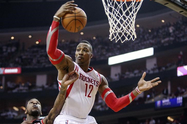 Apr 30, 2014; Houston, TX, USA; Houston Rockets center Dwight Howard (12) gets a rebound during the second quarter against the Portland Trail Blazers in game five of the first round of the 2014 NB ...
