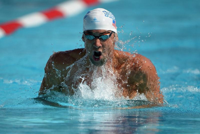Aug 10, 2014; Irvine, CA, USA; Michael Phelps swims 1:58.74 in a 200m individual medley heat to advance to the final in the 2014 USA National Championships at William Woollett Jr. Aquatics Complex ...